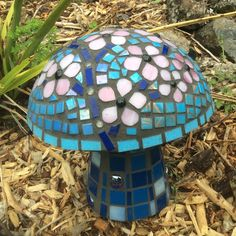 Cherry Blossom Mosaic Mushroom made from left over tiles a friend gave me after having a swiming pool built