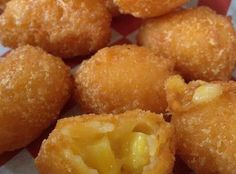 Corn nuggets 1 (11 ounce) can creamed corn 1 (11 ounce) can whole kernel corn, drained 1/2 cup yellow cornmeal 1/2 cup all-purpose flour 1 egg white 2 tablespoons milk salt and pepper to taste 3 cups vegetable oil for deep frying