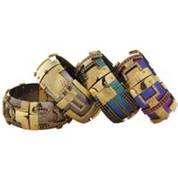 Kara Ross: small titanium cuffs with 18k gold, multicolored sapphires, and diamonds