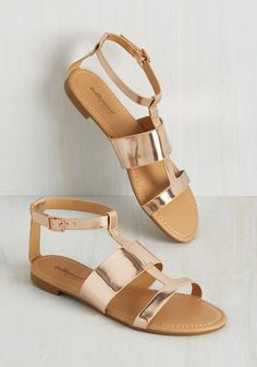 While these metallic sandals may not match every single outfit right out of the gate, be patient - their smooth, rose gold vegan faux leather will find its way into each ensemble when the time is right! A simple, strappy pair with copper buckles, these glads are a surprisingly versatile.