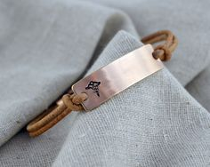 This is security in style, pair this beautiful charm with the color cording of your choice for a versatile accessory. - Sterling Silver, Rose Gold Fill or Gold Fill on leather - Choose your finish - L