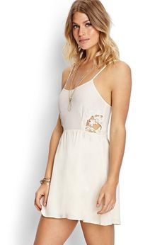 This crepe woven cami dress features crocheted side panels and adjustable shoulder straps. Comple...