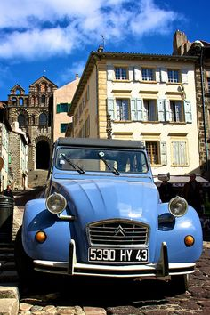 France  What could sum up France more than a Citroen 2CV in the ancient town of Le Puy-en-Velay. Lookup up to the magnificent cathedral.