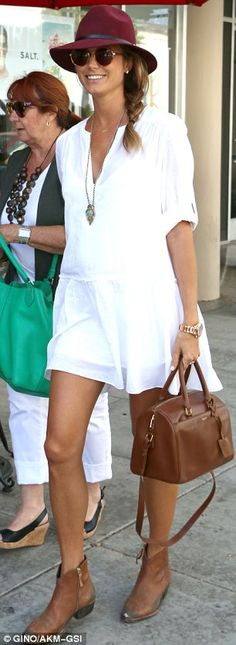 Pregnant Stacy Keibler sported cowgirl style ankle boots and a red felt fedora with her flowing white dress http://dailym.ai/1pIkxp8