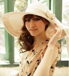 3e4d01057f3 Cream-colored Fashion Womens Bow Large Brim Summer Beach Straw Sun Hat
