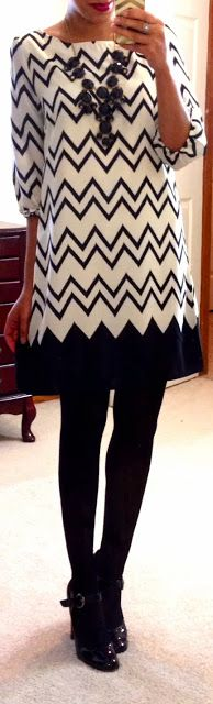 black statement necklace + {black and white} Flourish Boutique Lightning Storm Chevron Dress + black tights + black pumps