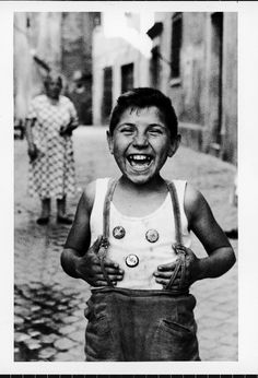 A laughing boy on the street in Trastavere, Italy. Photo by Carlo Bavagnoli, 1958.