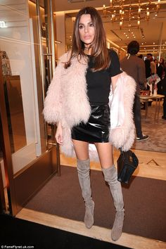 Wow factor:Misse glammed up for the fashion bash, showing off her long legs in a pair of grey suede over-the-knee boots