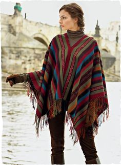 Strikingly beautiful, our traditional poncho is handwoven of vegetal-dyed yarns by Quechua women in the highlands of Peru. Authentic in every detail and sourced from a textile cooperative dedicated to ensuring the survival of Andean weaving. Cayenne, teal, olive and chicory wool (90%) and alpaca (10%), finished with a row of festive fringe.