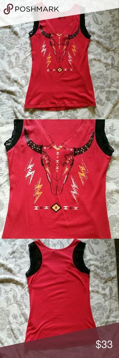 Bull Skull Tank Top Absolutely awesome tank. Just a little too big for me. Great bull graphic and accenting lace. In excellent condition. No flaws. Cruel Girl Tops Tank Tops