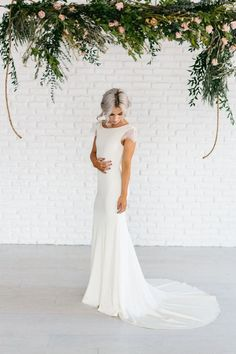 stunning lace sleeve and cowl back wedding dress