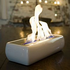 Brasa Avani portable fireplace runs on denatured alcohol fuel (Bioethanol)