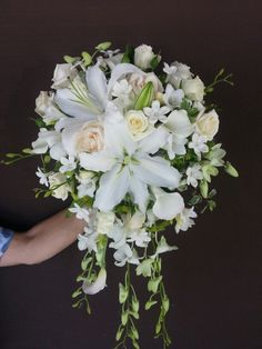 #Cascading #bouquet with #orchids,  #lilies, #stephanotis, #roses and #freesia #white
