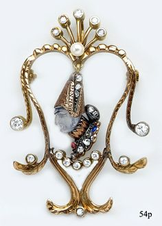 Art Nouveau Moonstone Cameo, Rose-cut Diamond, Ruby, Natural Pearl and Carved Gold Pendant/Brooch.