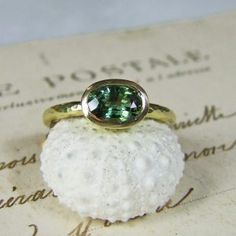 green sapphire oval ring