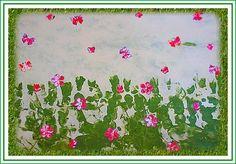 Des empreintes de main pour l'herbe et des fleurs à la perforatrice