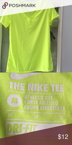 NWT Nike DriFit neon yellow short sleeve t NWT Nike DriFit neon yellow shirt sleeves t-shirt.  Medium 100% polyester- will consider all reasonable offers Nike Tops Tees - Short Sleeve