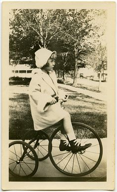 Love the hat, coat, shoes, tricycle.