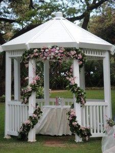 pink flowers wrapped around gazebo