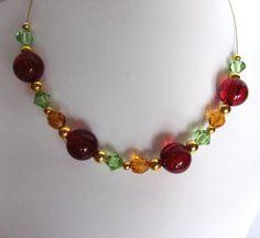 collier avec gros perles rouge vert ocre perles par ManuelledeParis
