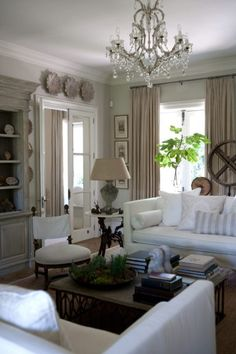 love this neutral room - white flanking sofas a definite go-to style