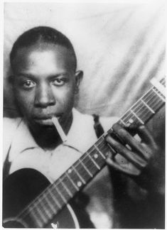 Robert Johnson, from a photo booth.  One of only two undisputed photographs of the Delta blues master.  The other is a studio shot of him smiling, seated with a hat on.  There are no film clips of Johnson known to exist.