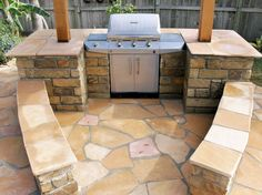 Outdoor grill area with low walls for seating