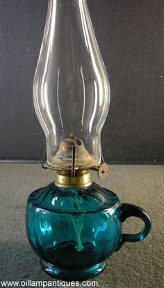 It is hard to be sure of where this lovely little blue glass kerosene lamp was made. This style of collar was used with both British and Australian lamps.