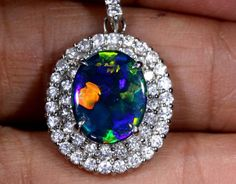 28.55 CTS SOLID BLACK OPAL PT-900 AND DIAMOND PENDANT INV-826 GC black opal pendant, opals in diamond