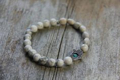 Blessing Beads bracelet by Wanderbird. Made from howlite, turquoise, Job's Tear seeds and a Hamsa charm. Hamsa, Blessing, Seeds, Beaded Bracelets, Charmed, Turquoise, Trending Outfits, Unique Jewelry, Handmade Gifts