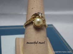 Genuine Pearl In 14 Kt Gold Plate Snake Setting by BobsFashionJewelry on Etsy