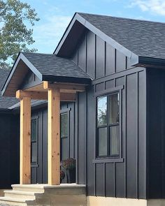 Ranch Farmhouse HardiePanel vertical siding, paired with HardieTrim batten strips for a board-and-batten look. Seen here in the color Black Water. Cottage Exterior, Modern Farmhouse Exterior, Exterior House Colors, Farmhouse Plans, Exterior Design, Young House Love, Exterior Siding, Exterior Remodel, Exterior Paint