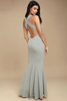 You'll be a divine display in the Heaven and Earth Grey Maxi Dress! Medium-weight stretch knit forms a sleeveless bodice, with plunging V-neck, darting, and wide straps that cross atop an open back. Bit of elastic at the waist tops the figure-flaunting maxi skirt. Hidden back zipper/clasp.