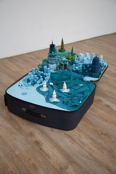 In her work 'Portable City', artist Yin Xiuzhen collects clothes worn by people in different cities and uses them to create miniature models of them inside a suitcase. To provide the viewer with the whole experience, the suitcase also plays a tape with the local soundscape.