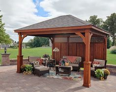 Wood Traditional Pavilion with Stain, Superior Posts and Privacy Panel http://www.backyardunlimited.com/pavilions.php