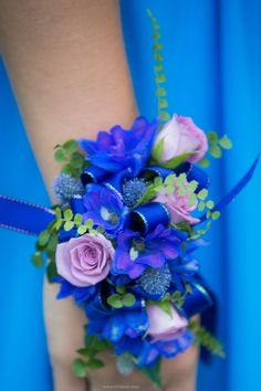 Custom blue and lavender prom corsage wristlet by Viviano Flower Shop