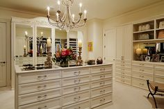 This spacious closet in Nashville includes Niermann Weeks Danieli Chandelier. Design by Linda Ashley Interior Decoration. niermannweeks.com #NiermannWeeks