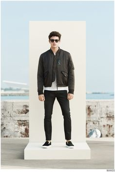 Shop this look on Lookastic:  http://lookastic.com/men/looks/bomber-jacket-crew-neck-t-shirt-jeans-slip-on-sneakers-sunglasses/9863  — Olive Bomber Jacket  — White Crew-neck T-shirt  — Black Jeans  — Black and White Slip-on Sneakers  — Dark Brown Sunglasses