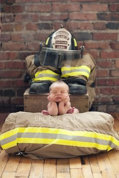 Newborn Firefighter photo....... Samantha this would be so cute to do with Ryan!! Thanks Alicia great find :)