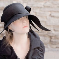Is she in mourning, do you think?  In any case that is one stunning chapeau.