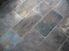 Image from http://solomonsbuildersinc.com/resources/Tile_n_Woodwork/slate-tile-floor-display.jpg.