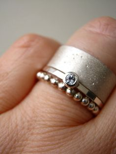 White Sapphire  Stacking/ Solitaire RING  Sterling by metalmorphoz, $88.00- the small rings would look great stacked with my wedding band