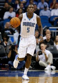 ORLANDO, FL - NOVEMBER 03: Victor Oladipo #5 of the Orlando Magic brings the ball up the court during the game against the Brooklyn Nets at Amway Center on November 3, 2013 in Orlando, Florida.