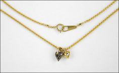 A MIZUKI BLACK DIAMOND AND 14 KARAT YELLOW GOLD NECKLACE. Lot 150-7269 #jewelry