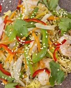 La Bauhinia - Singapore Fried Noodle - Stir-fried rice vermicelli with crunchy vegetables, shrimp, pork, cilantro, sesame seeds, curry paste and coconut milk.