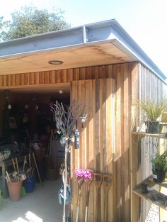 Detail of wooden shed with modern roof
