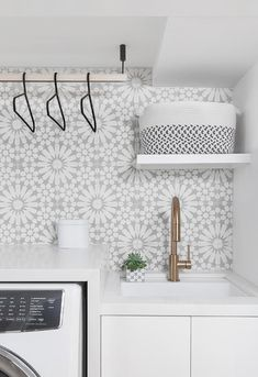 and gray mosaic tiles in a laundry room showcasing a sunburst pattern Whi. and gray mosaic tiles in a laundry room showcasing a sunburst pattern Whi. Laundry Room Tile, White Laundry Rooms, Laundry Room Cabinets, Room Tiles, Laundry Room Organization, Bathroom Floor Tiles, Laundry Room Design, Kitchen Wall Tiles, Kitchen Backsplash