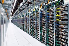 The rear of racks in Google's Oklahoma Data Center. Google uses different colored wires for each connection type so they easily know what to replace in the event of a failure.