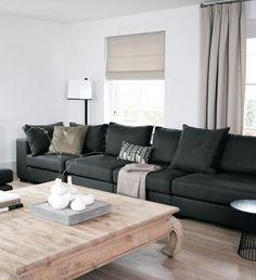 Charcoal grey sofa. A Rotterdam loft project From Natasja Molenaar's portfolio  - photos by Alexander van Berge
