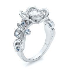 Custom organic flower halo, diamond and blue topaz engagement ring